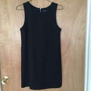 Little black sleeveless dress with zippered back